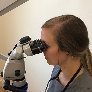 Dr. Watts using Zeiss microscope