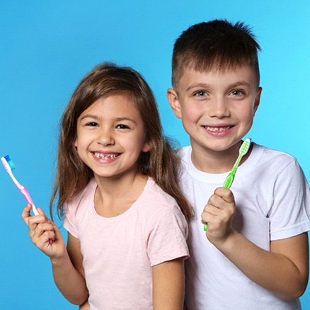 kids with toothbrushes
