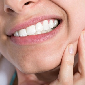 Close-up of woman rubbing cheek due to tooth pain