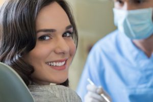 woman smiling dental chair